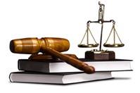 Muốn khiếu nại hoặc khởi kiện vi phạm của cán bộ đất đai huyện thì kiện ở đâu?